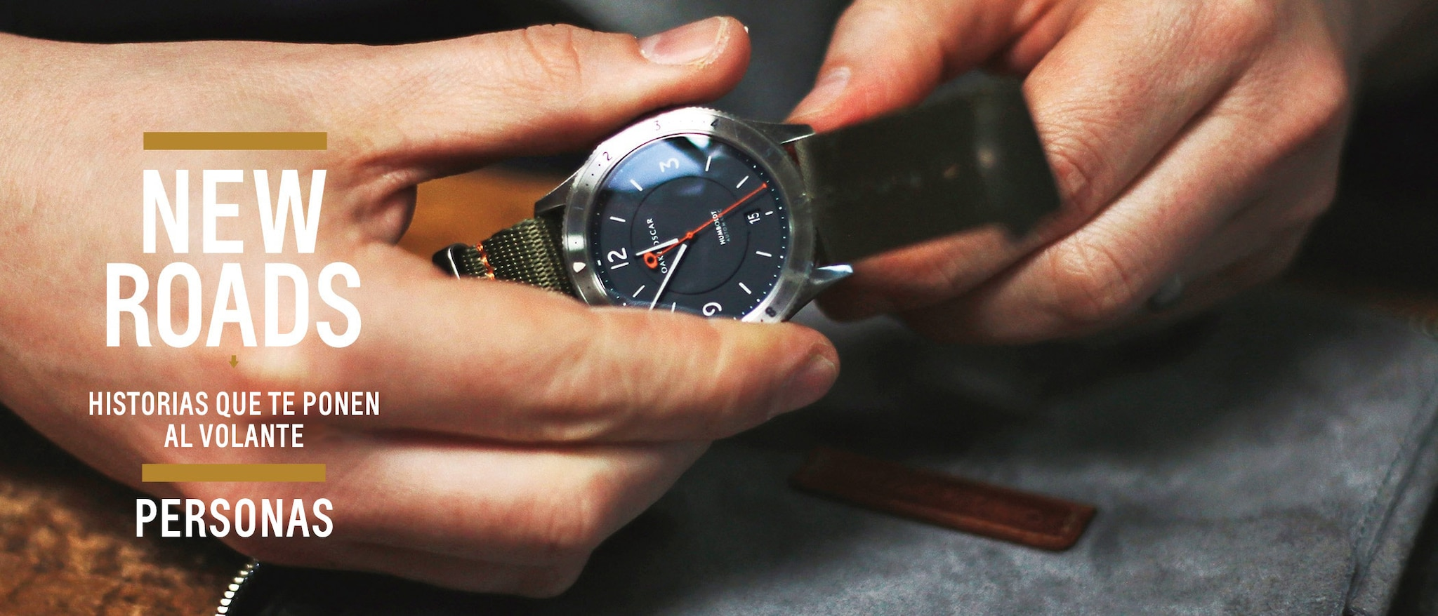 A close-up of hands holding a watch.