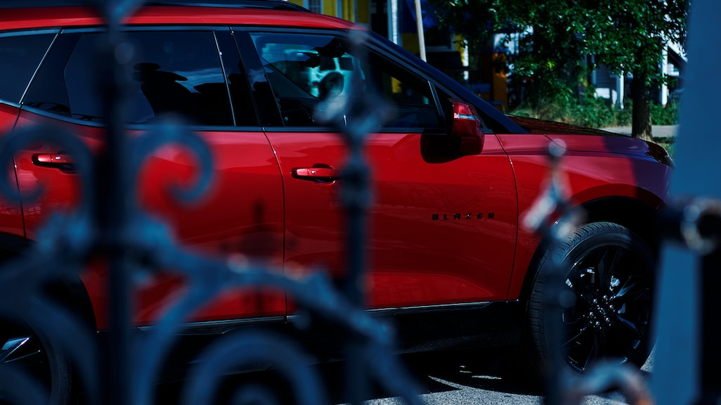 A red Chevy Blazer sits outside Muriel's Jackson Square restaurant in New Orleans as the sun lights up the buildings across the street.
