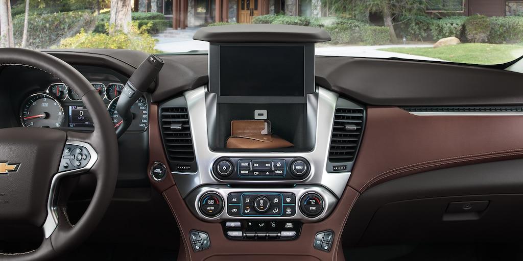 Almacenamiento del tablero central de la SUV grande Suburban 2020